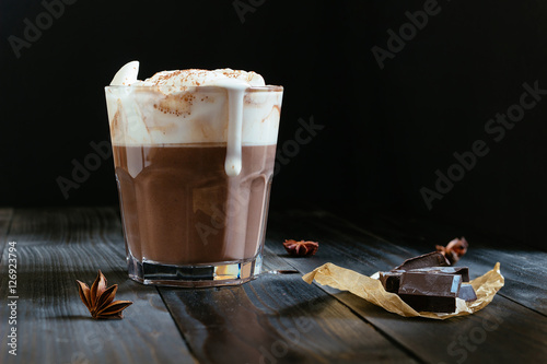 Tuinposter Chocolade hot chocolate with whipped cream on the black table