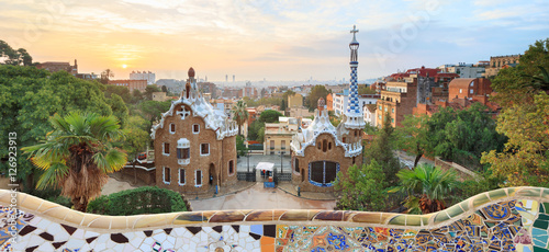 Foto op Canvas Barcelona Park Guell in Barcelona. View to entrace houses with mosaics on foreground