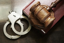 Gavel And Handcuffs With Red L...
