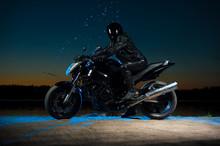 Motorbiker In Helmet Sitting O...