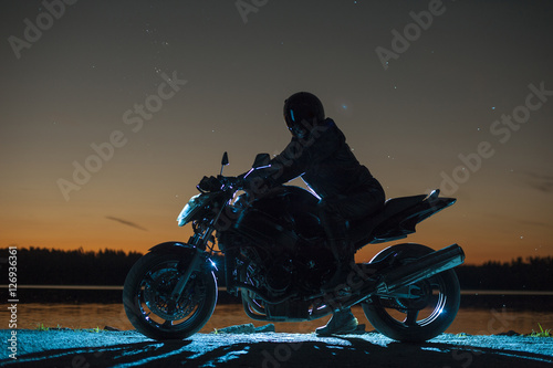 Male biker sitting on motorbike Canvas Print