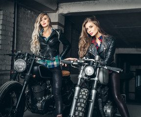 Fototapeta na wymiar Bikers women in leather jackets with motorcycles