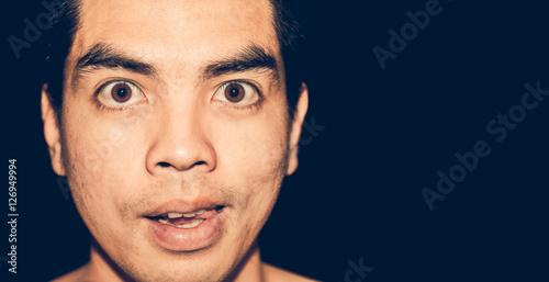 Fotografie, Obraz  Closeup insidious face asia man.