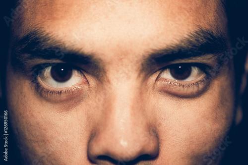 Fotografie, Obraz  Closeup insidious face asia man.Vintage or retro tone.