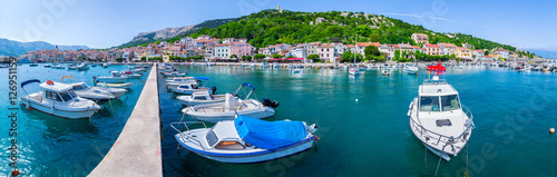 Foto auf Leinwand Stadt am Wasser Wonderful romantic summer afternoon landscape panorama coastline Adriatic sea. Boats and yachts in harbor at cristal clear turquoise water. Baska on the island of Krk. Croatia. Europe.