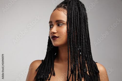 Obraz black woman's profile. African braids. false hair concept - fototapety do salonu