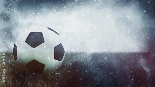 Poster Glisse hiver Soccer ball in grass as grunge sports background