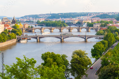 Poster Praag Panorama of the old part of Prague from the Letna park. Beautiful view on the bridges over the river Vltava at sunset. Old Town architecture, Czech Republic.