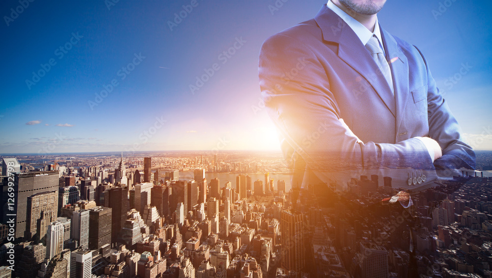 Fototapety, obrazy: Double exposure of a businessman in front of a big city
