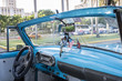 Dashboard of classic American car in Cuba with American and British flags