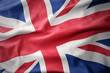 waving colorful flag of great britain.