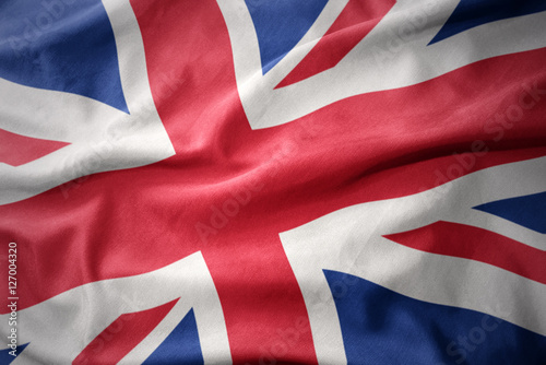 waving colorful flag of great britain. Wallpaper Mural