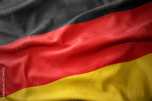 waving colorful flag of germany. Wallpaper Mural
