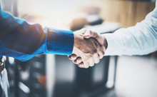 Close Up View Of Business Partnership Handshake Concept.Photo  Two Businessman Handshaking Process.Successful Deal After Great Meeting.Horizontal, Blurred Background.