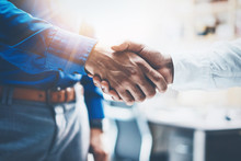 Close Up View Of Business Partnership Handshake.Concept Two Businessman Handshaking Process.Successful Deal After Great Meeting.Horizontal,flare Effect, Blurred Background.
