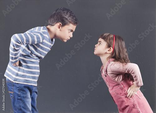 Vászonkép  Brother and sister having an argument
