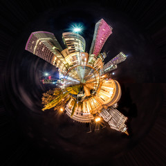 Obraz na SzkleMiniature tiny planet of Night skyline of Warsaw with soviet era Palace of Culture and science and modern skyscrapers. 360 degree montage from 20 images