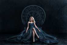 Blonde Woman Sitting On The Throne