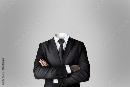 businessman without head crossed arms grey background Canvas-taulu