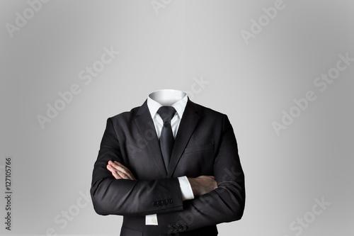 Fotografia, Obraz businessman without head crossed arms grey background