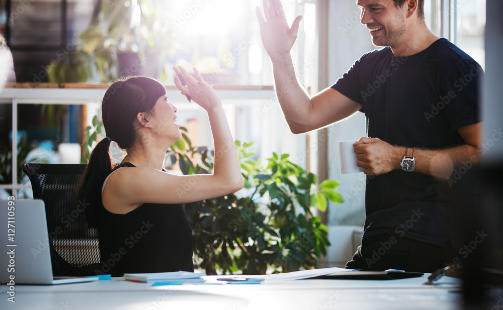 Fototapety, obrazy: Successful business colleagues giving high five