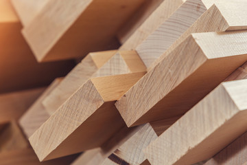 Fototapeta Wood timber construction material for background and texture. close up. Stack of wooden bars. small depth of field