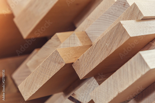 plakat Wood timber construction material for background and texture. close up. Stack of wooden bars. small depth of field