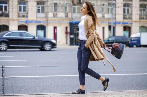 Fotografie, Obraz  Portrait of a young beautiful woman in beige coat