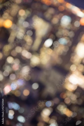 Fotografiet  Defocused abstract metropolitan city blur of buildings with lens flare shot in N