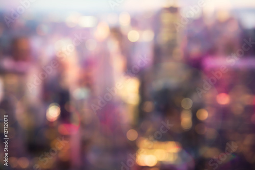 Fototapeta Defocused abstract metropolitan city blur of buildings with lens flare shot in New York City