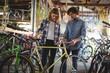 Mechanics examining bicycle