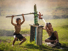 Two Young Boy Rocking Groundwater Bathe In The Hot Days, Country