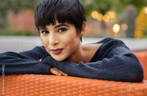 Valokuva  Attractive young woman with short stylish hair and friendly smile