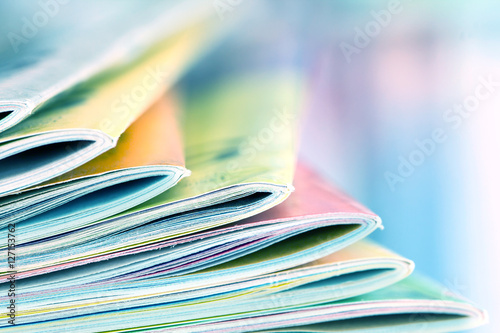 Fotografie, Obraz  Close up edge of colorful magazine stacking