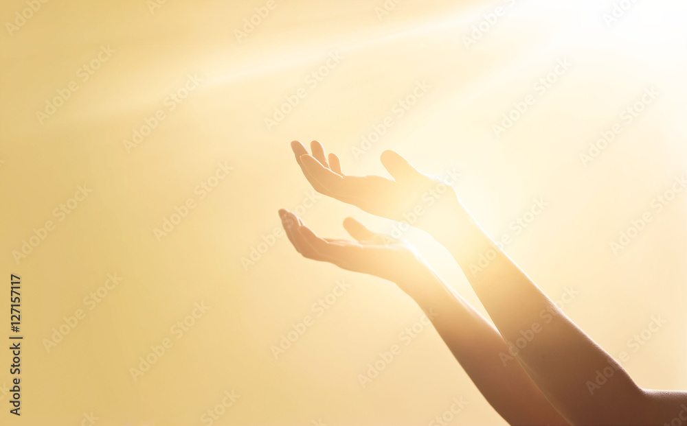Fototapeta Woman hands praying for blessing from god on sunset background