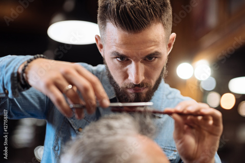 Close up of young male hairdresser cutting hair Canvas Print