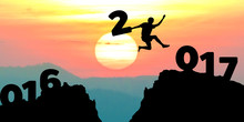 Silhouette Man Jumps To Make The Word Happy New Year 2017 With S