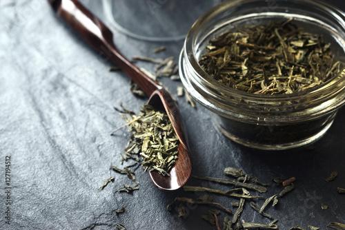 Obraz na plátně Set for tea preparation on the stone dark stone table horizontal