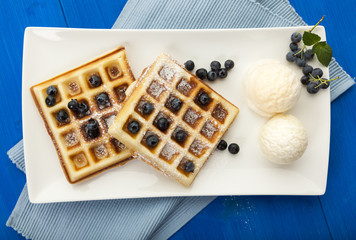 Blueberry waffles with vanilla ice cream