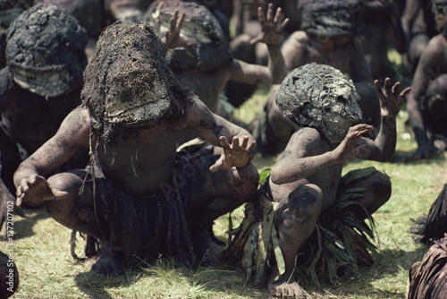 Mud men wearing clay masks perform ritual dance, Asaro Valley, Papua New Guinea, Pacific Islands, Pacific