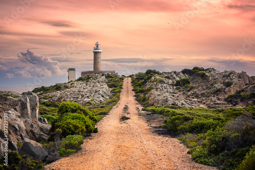 Stickers pour porte Phare Country road in perspective leading to the lighthouse at sunset