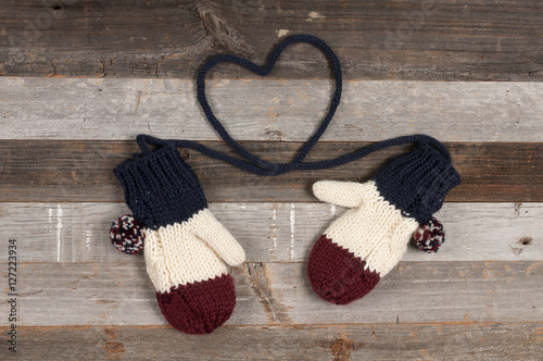 Fotografie, Obraz  Winter clothing, knitted mitten on wooden background