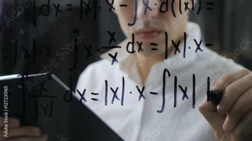 scientist wrote mathematical formulas on a blackboard