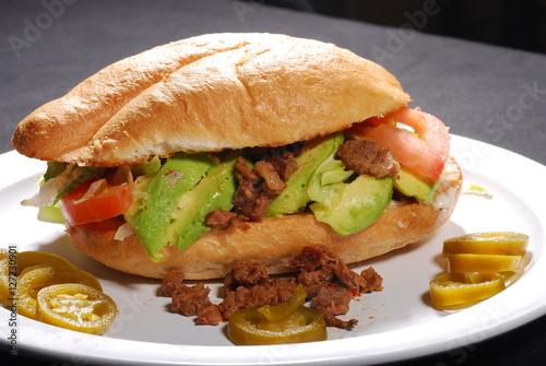 Fotografie, Obraz  Torta de carne asada con aguacate, tomate y jalapeños