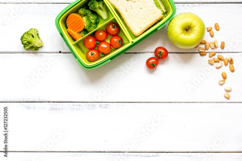 preparing lunch for child school top view on wooden background