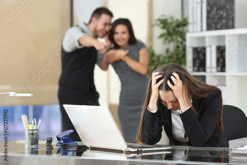 Businesspeople bullying a colleague at office Wallpaper Mural