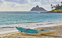 Outrigger Canoe On Tropical Island Beach And Palm Trees