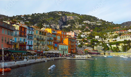 Fotobehang Liguria Colorful buildings with traditional architecture near the harbor of Villefranche sur Mer, French Riviera, France