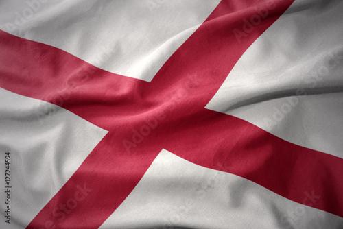 waving colorful flag of alabama state. Canvas Print