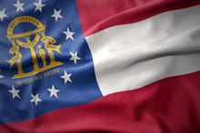 Waving Colorful Flag Of Georgia State.